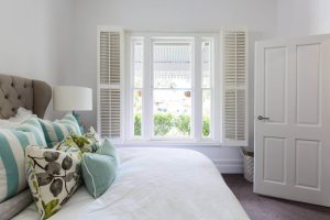 Sash-window-with-plantation-shutters