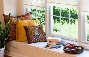window-seat-with-sash-windows-books-and-cushions